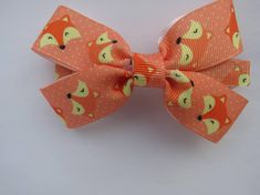 Foxes on light orange background/4 inch hair bows/bows with