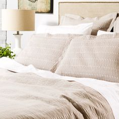 Textured coverlet and shams that are also really chill and relaxed.