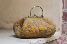 Hey, I found this really awesome Etsy listing at https://www.etsy.com/listing/160794137/felted-hand-bag-with-metal-handle