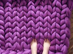 Ukraine-based Anna Mo knits super chunky blankets with giant, three-inch stitches.