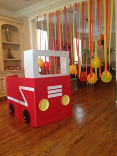 Firefighter birthday party: Fire truck made with a large box and additional card board for the windshield. Materials: butcher paper (from art supply store), white duct tape (Party City or art supply store), Dollar Tree paper plates and many glue sticks.