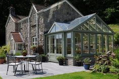 Have the conservatory/greenhouse attached to the kitchen with doors to the back patio What Is A Conservatory, Conservatory Design, Conservatory House, Extension Veranda, Skylight Shade, Stone Houses, Glass House, Winter Garden, Cabana
