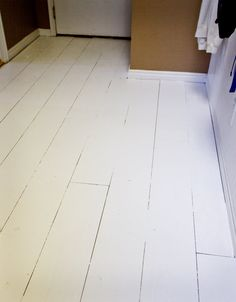 sheets of plywood; cut into 8 inch strips, laid like a regular hardwood floor, painted white and then polyurethane. Old farm house look ; Plywood Plank Flooring, Diy Flooring, Hardwood Floors, Basement Flooring, Bedroom Flooring, Flooring Options, Farmhouse Flooring, Old Farm Houses, Painted Floors