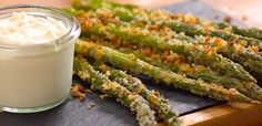 "We don't often say ""Once you start, you can't stop"" about eating asparagus, but our crispy garlic & Parmesan-crusted asparagus is as addictive as potato chips."