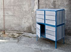 Cabinet made from recycled newspapers to resemble wood.