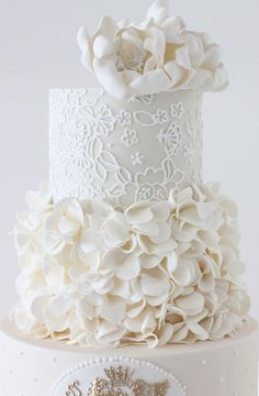 All these textures give great visual impact on this all white wedding cake l http://eventsbyclassic.com For more wedding inspiration please visit www.lolabeeandme.com
