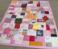 A quilt made from baby clothing - First Year Quilt - Jellybeanquilts.com