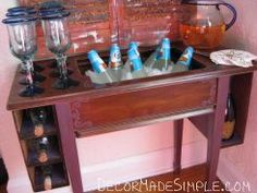 old sewing machine table converted into potting bench/mini bar