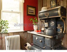 """Ideal Sunshine"" Vintage Cast-iron Stove Decor in Home Interior, USA - Stock Image"