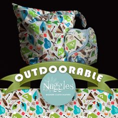 """Outdoorable - Hanging Wet Bag - Nuggles Design Canada - #Clothdiapers   18"""" x 24"""", with two handles that unsnap, you can hang it anywhere! Link the two together for one sturdy handle! Can also be used to line a small pail.  Our nifty mesh-lined pouch allows you to put essential oils or a scented disc, or even carbon filter (just remember to remove before washing.) Holds approximately 15-20 diapers, OR dirty laundry, towels and swim suits, funky sports equipment .... the list goes on!"""