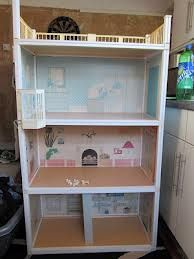 Sindy Doll House - Not quite the one we had, as my Dad cut the top off and made an extension... because my sister couldn't reach the roof! ;)