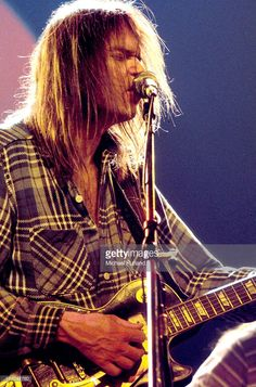 Neil Young performs on stage at Hammersmith Odeon, London, 28th March 1976.