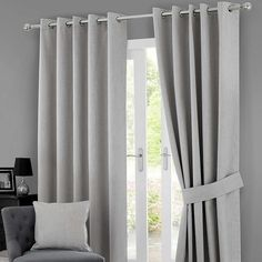 Solar Grey Blackout Eyelet Curtains | Dunelm