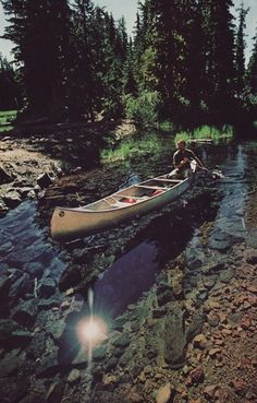 Canoeing down a stream