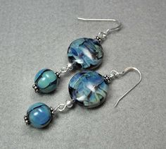 Ahhh, more lampwork!  If I recall correctly, I made this with some very unique glass that has silver in it, which makes the colors shift and glow.  Enjoy!  :)
