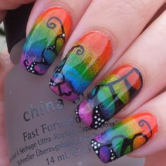 sponge application with free hand black butterfly detailing free hand nail art, rainbow, bright multi-color, Gay Pride