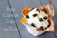 Cannoli Cups    1 package (16 oz.) wonton wrappers  1 container (15 oz.) ricotta cheese  1/4 cup cornstarch  1 1/3 cups whole milk  1/2 cups powdered sugar  1/2 tsp. almond extract  1/2 tsp. vanilla extract  1/4 tsp cinnamon (optional)  2 cups mini semisweet chocolate chips  powdered sugar (for dusting)
