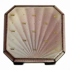 English hallmarked sterling silver compact with a pink guilloche enamel to front. Birmingham, 1949