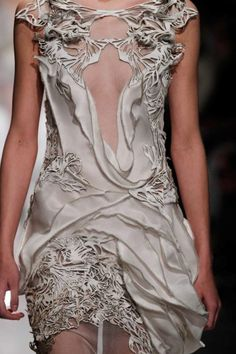 Luxurious laser cut pattern and lovely layered texture detail resembling organic surface patterns found in nature - closeup fashion; dress details
