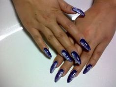 love the design... not sure of the stiletto nails though