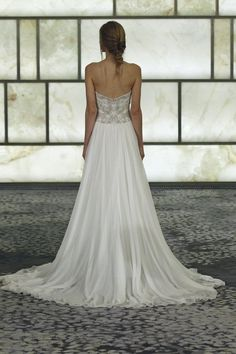 "This gown has a beaded strapless bodice with a gorgeous flowing length, laying longer in the back. Dress and veil still with Tags, she ""changed her mind""."