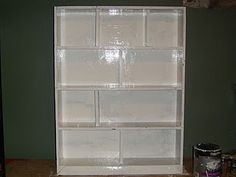 How to make a dollhouse from a bookshelf.