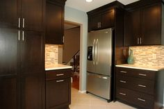 Dark cabinets & great backsplash