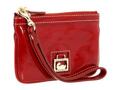 A sleek patent accessory from Dooney Bourke belongs in every woman's wardrobe. Wristlet constructed of luminous patent leather. Holds your currency, identification and a slim cell phone. Single adjustable wrist strap. Signature logo-engraved hardware.