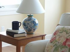 This blue and white Italian ceramic lamp by Tuscia d'Arte is the perfect accent to the living room. Fill that blue mug by Gorky Gonzalez with some coffee or tea and prepare for a quiet afternoon with your favorite book. #homedesign #livingroom #decorating  #gorky #gogo #blueandwhite $265