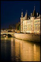 Conciergerie reflected in Seine river at night. Paris, France ( color)