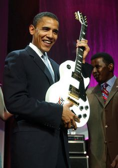 Barack Obama, at the time still an Illinois Senator, holds a Gibson guitar presented to him after winning the Rock The Nation Award in Washington in Black Presidents, Greatest Presidents, American Presidents, First Black President, Current President, Joe Biden, Durham, Barak And Michelle Obama, Obama Campaign