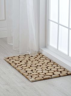 Use logs of woods on felt fabric to create a carpet or a table runner.