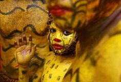 A boy with his body painted like a tiger waits backstage before performing during festivities marking the annual harvest festival of Onam in the southern Indian city of Kochi.
