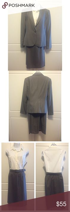 "Calvin Klein Dress & Blazer Suit Dress has button down top and grey skirt to match blazer, with a matching cloth belt. The white part is 97% cotton/3% spandex and the skirt of the dress and blazer are 80% polyester/20% rayon. Dress measures: 19"" bust, length is 39.5"". The skirt and blazer are fully lined in polyester. The blazer has a single button closer. It measures: 19"" at bust, sleeves 24"", length 24.5"", 16"" across  shoulders. The white top of the dress is a little yellowed from storage…"