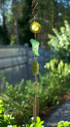 A beach glass and copper suncatcher wind chime with brass chimes. The 3 artist-made copper wrapped beach glass pieces are smooth with a mat finish. This sun catcher chime measures 29.5 inches from the