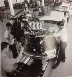 Vintage pic of Boss Mustang w/ 429 motor being shoehorned into the engine bay on the Ford Assembly line.
