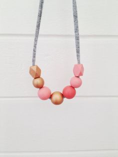 handpainted wooden bead necklace on recycled fabric string - round and geometric beads in coral and copper - petite size