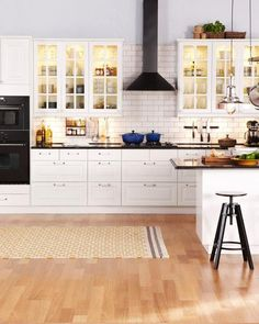 Far wall is another example of double ovens, counter, stove top. Layout example only.