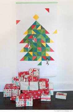 "Getting a $70 tree not in your budget? Try making one of your own! Check out this post for some inspiration. (I am picturing a hi-res greyscale photo of a tree, a 36x48"" Oce print on green paper [$8.16], and some tape)"