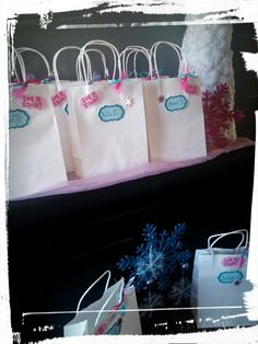 We made our own DIY Disney Frozen Snow Themed Gift Party Favor Goody Bags for Berkley and Brinley's Guests!