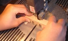 Franklin Phonetic School - Cutting puzzle pieces on the band saw.   New Project Ideas - Woodworking - Woodworking Teachers