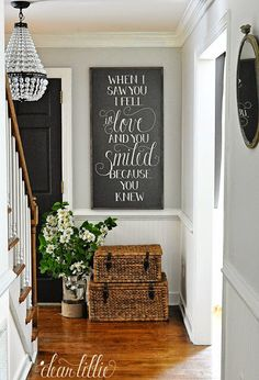 """These @homegoods baskets below our """"When I saw you I fell in love, and you smiled because you knew"""" sign are on of my favorite finds. They make the perfect spot to store shoes. It's practical seeing how they are right next to the front door but also still keeps things looking tidy and organized. (sponsored pin)"""