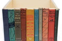 Use the spines of dilapidated books to create clever and camouflaged storage.