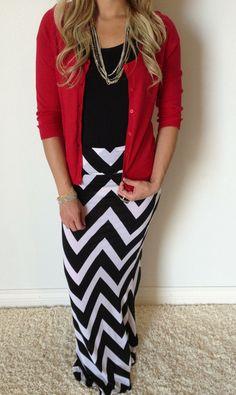 Red cardigan, black top, b/w chevron skirt