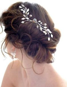Romantic vintage hairstyle with what looks to be a comb.