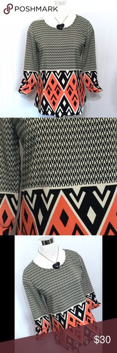 Amazing Chevron Geometric Tunic Blouse Small Like new. Perfect condition. Optional button up sleeves. Bold print. Very eye catching. Oversized small nouvida Tops Blouses