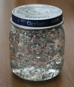 Snow Globe!  Fill the jar 1/3 with corn syrup. Fill the rest with water, add glitter and voila! Your very own snow globe.