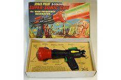 "Lot A Space Pilot 3 colour super sonic toy gun by Merit. Although with ""Dan Dare"" artwork apparently unlicensed. Vintage Toys 1960s, 1960s Toys, Retro Toys, Pulp Fiction Comics, Steampunk Gun, Space Toys, Childhood Toys, Childhood Memories, Farm Toys"