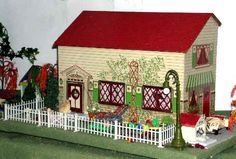 """1940s dollhouse. Because the masonite used in this house is stamped """"Made in Canada"""", it is tempting to think it was made by some as yet unidentified Canadian company, likely struggling for survival against the market domination of American toy companies."""