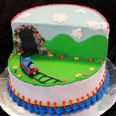 Thomas the Train cake made with buttercream.  I made this for my son's 2nd birthday